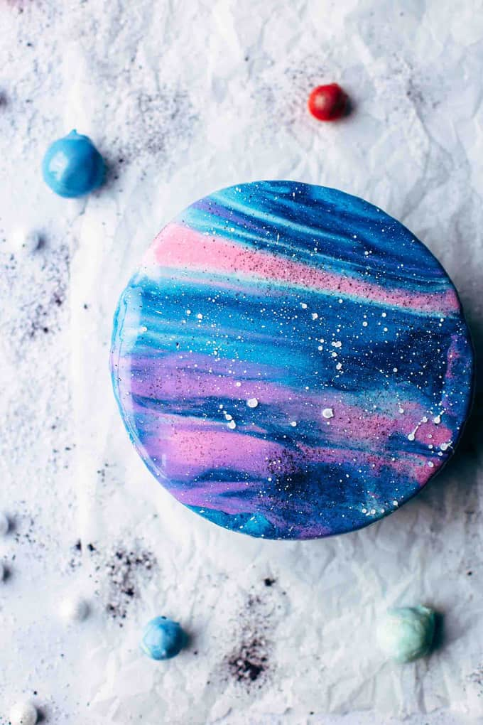 Overhead shot of the finished Mirror Glaze Galaxy Cake on white background