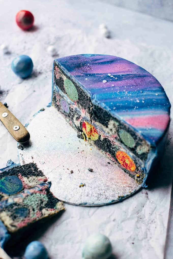Cut Mirror Glaze Galaxy Cake shown from a 45degree angle