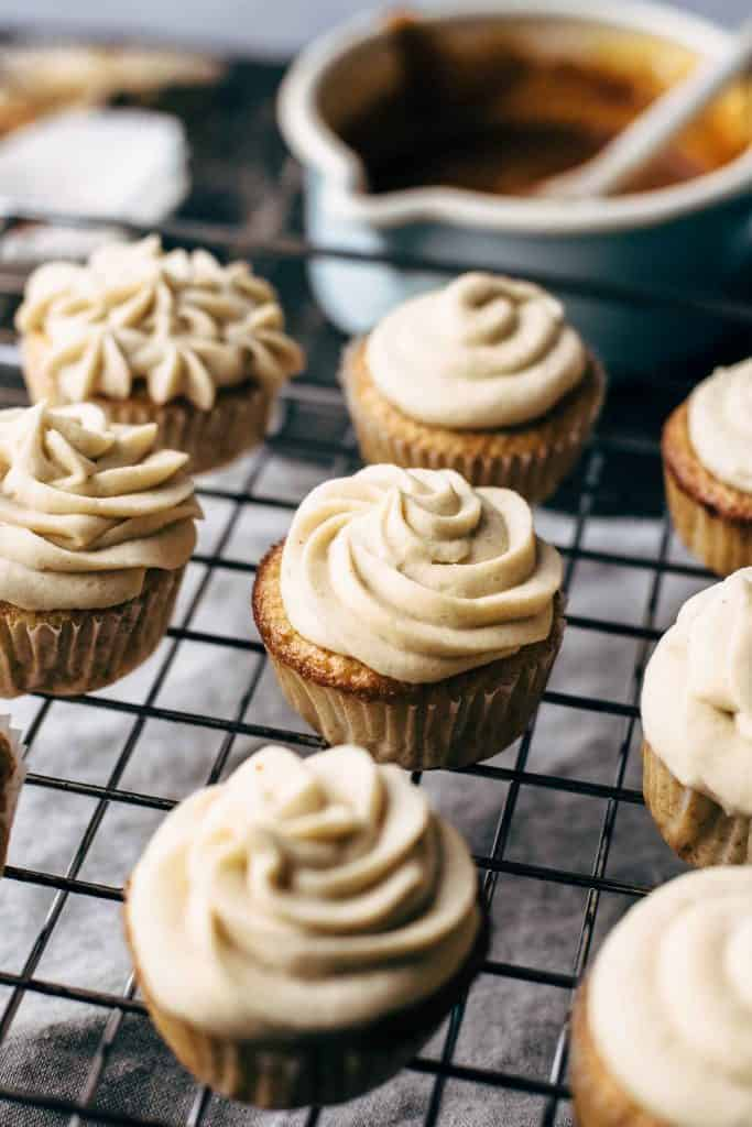 Vanilla cupcakes on a wire rack