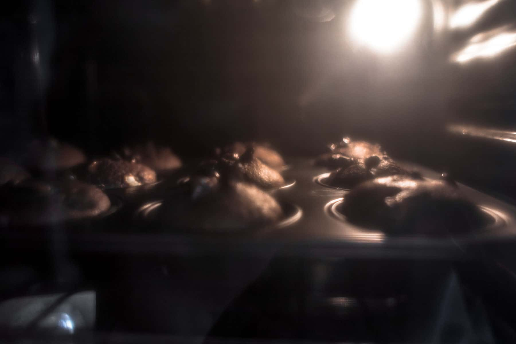 Baking Chocolate Banana Muffins in oven