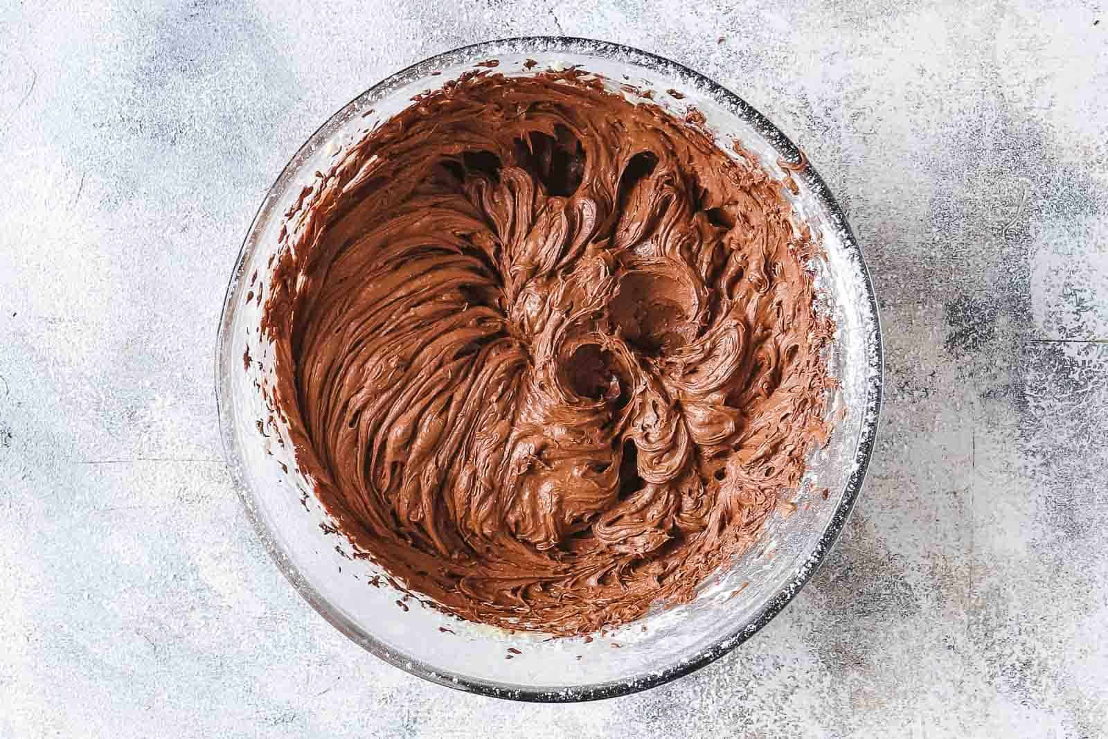 chocolate frosting in bowl