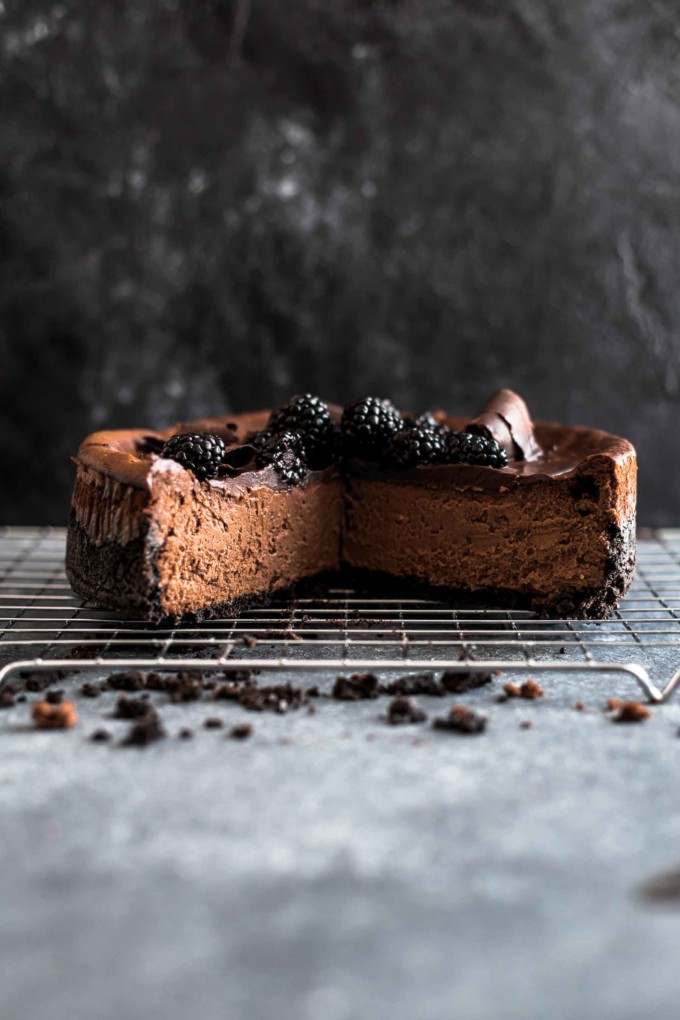 Cut chocolate cheesecake on a wire rack