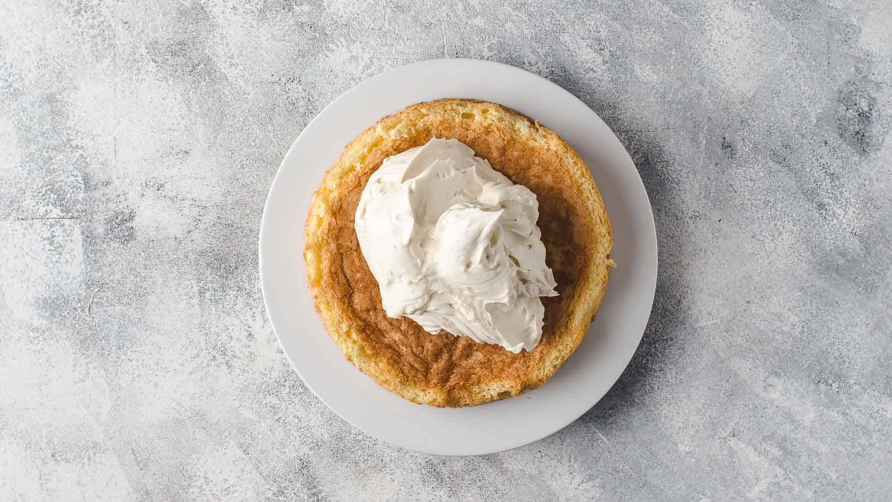 Mascarpone cream on top of first cake layer