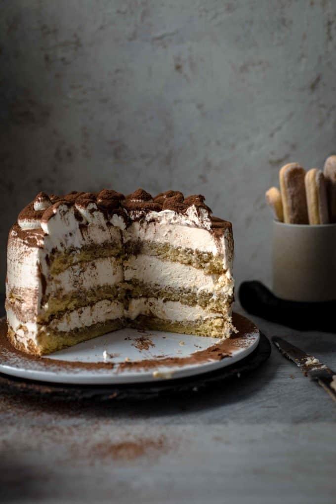 Cut Tiramisu Cake on a serving plate