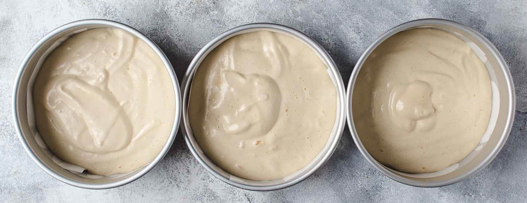 Cake batter in baking pans