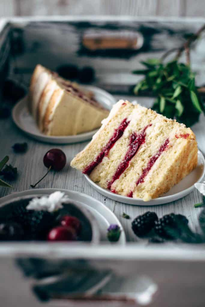 Cut cherry cake slices on plates
