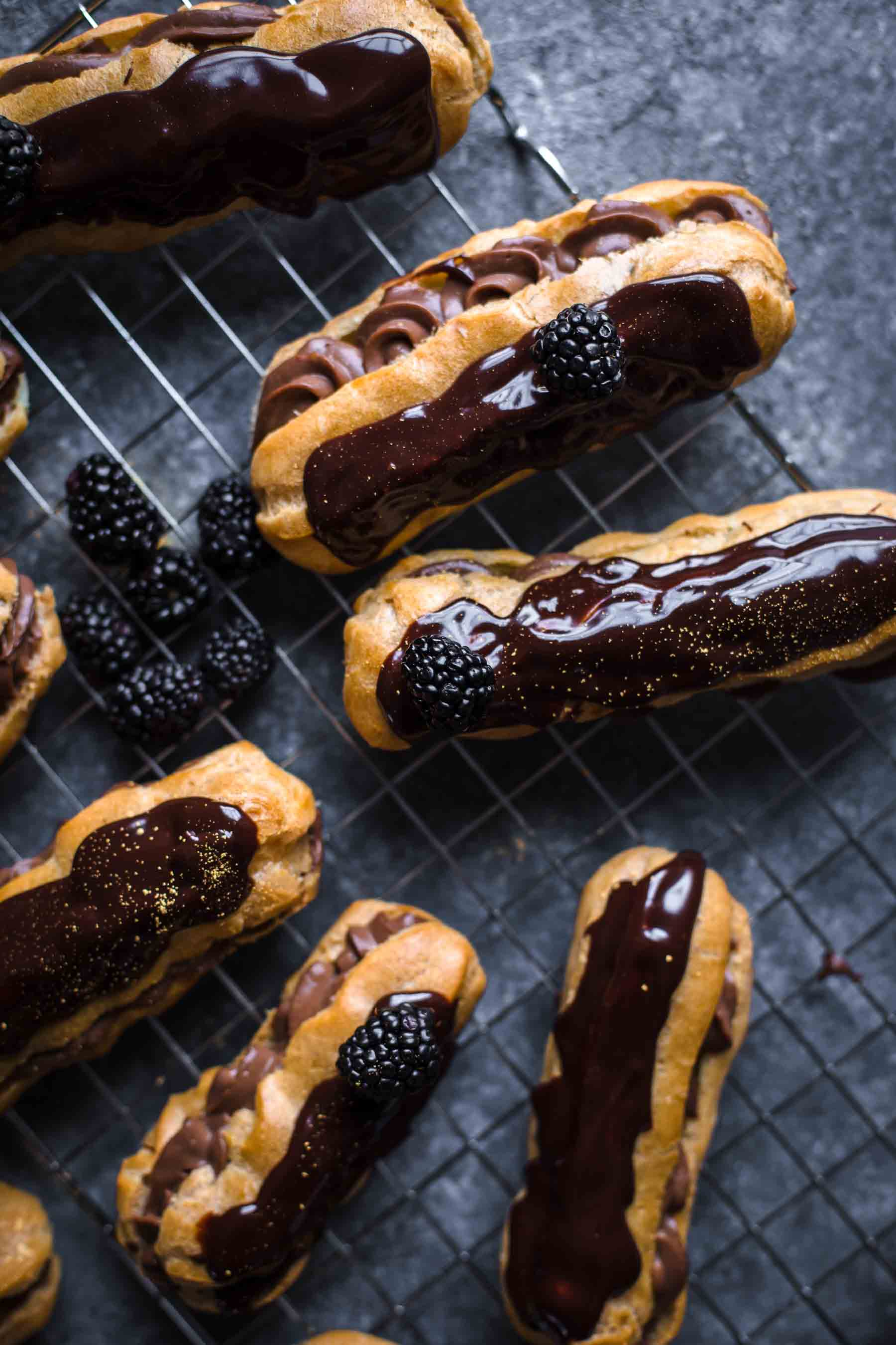 ready to serve chocolate eclairs on wire rack
