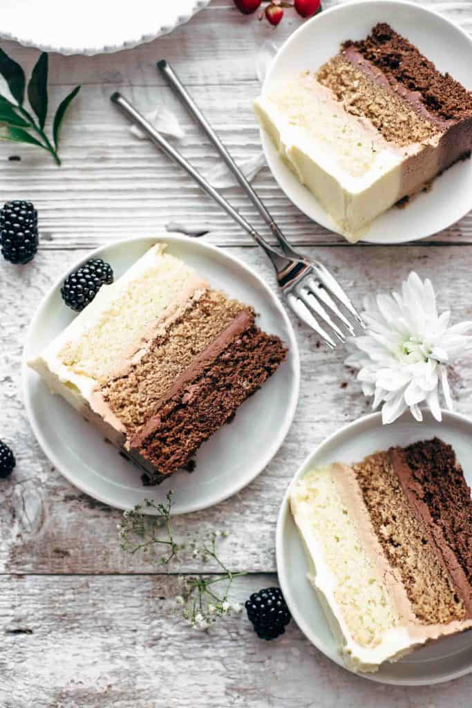Cut slices of chocolate cake on dessert plates