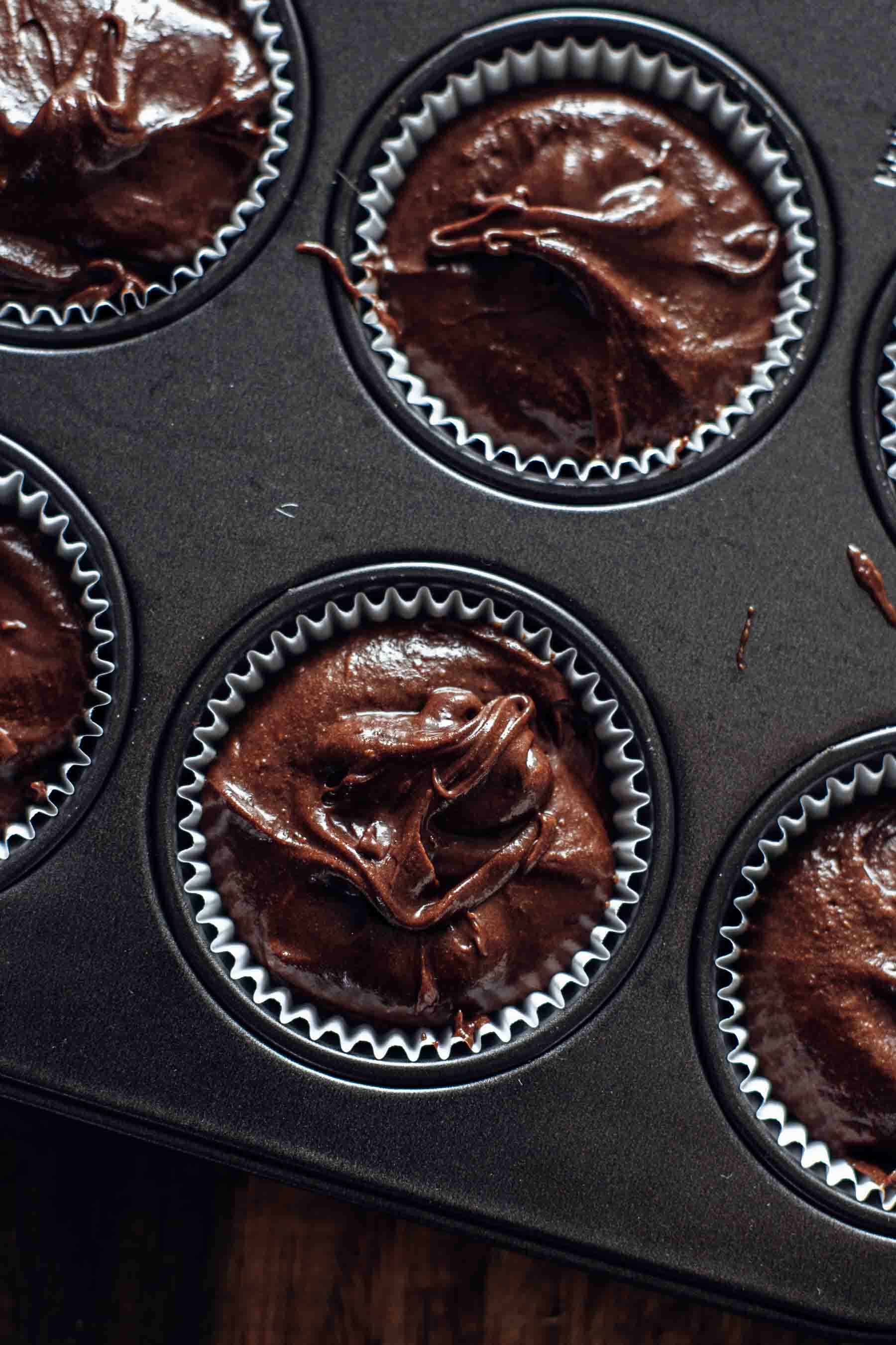 Unbaked Brownie Cupcakes Batter in muffin pan