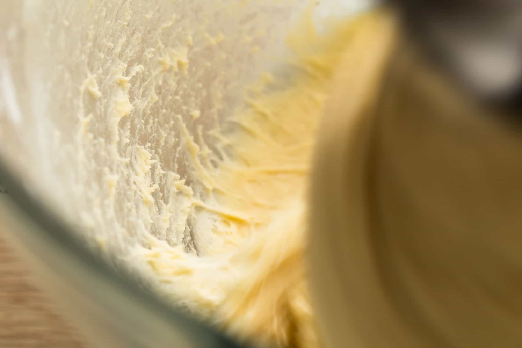 ingredients being mixed in mixer for cinnamon rolls