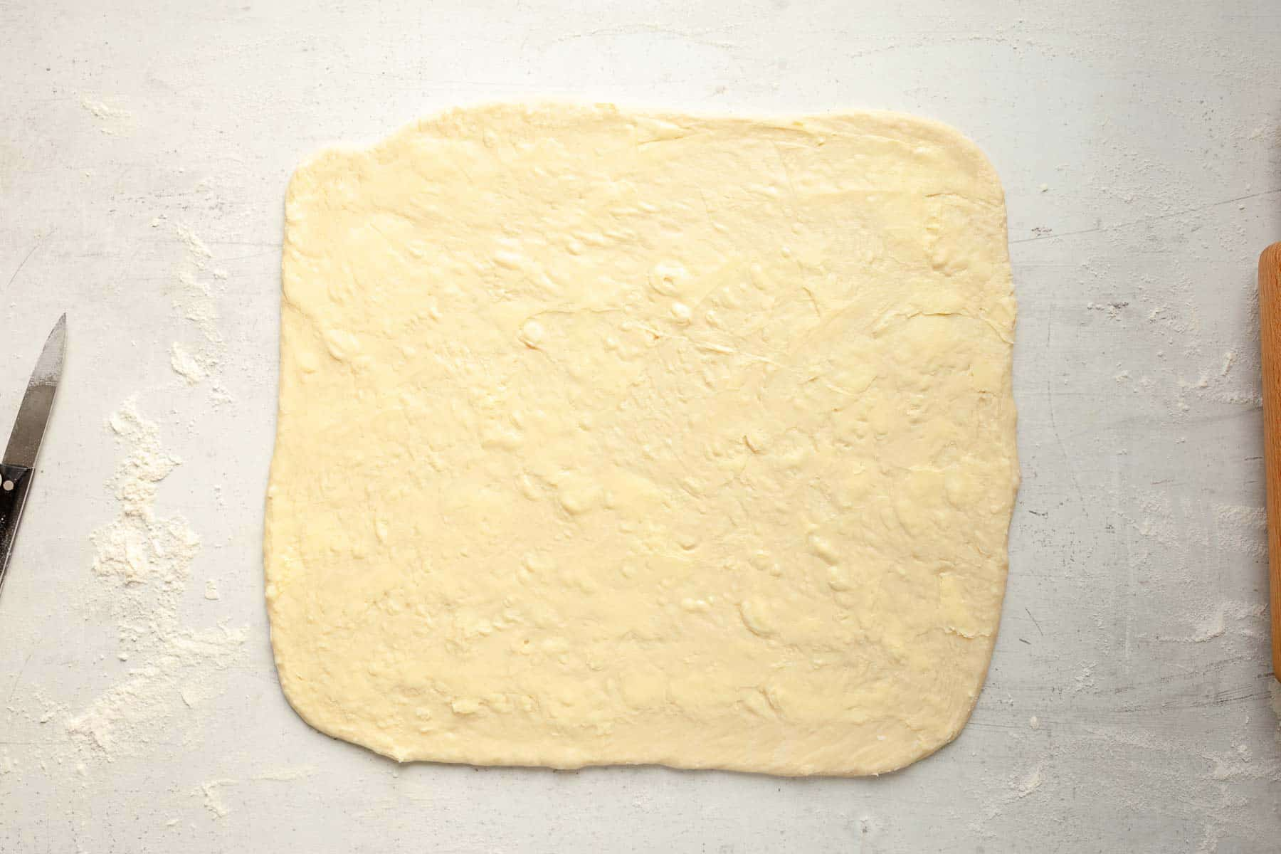 dough rolled into rectangle for chocolate rolls