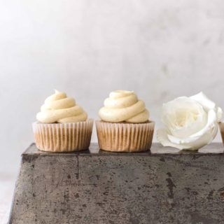 Banana Cupcakes with Cream Cheese Frosting on top of a pan
