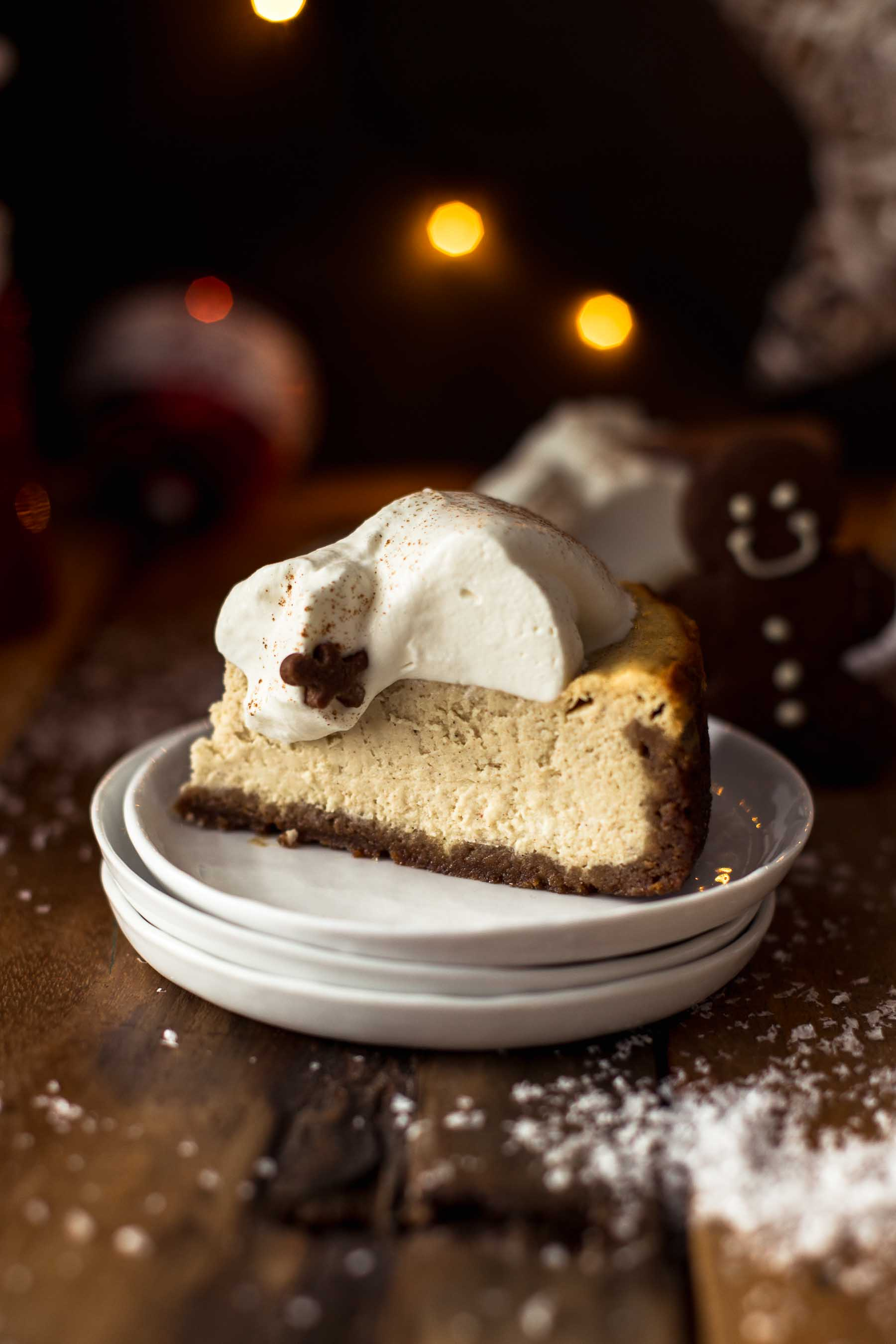 A slice of Baked Eggnog Cheesecake with Gingerbread Crust on plates