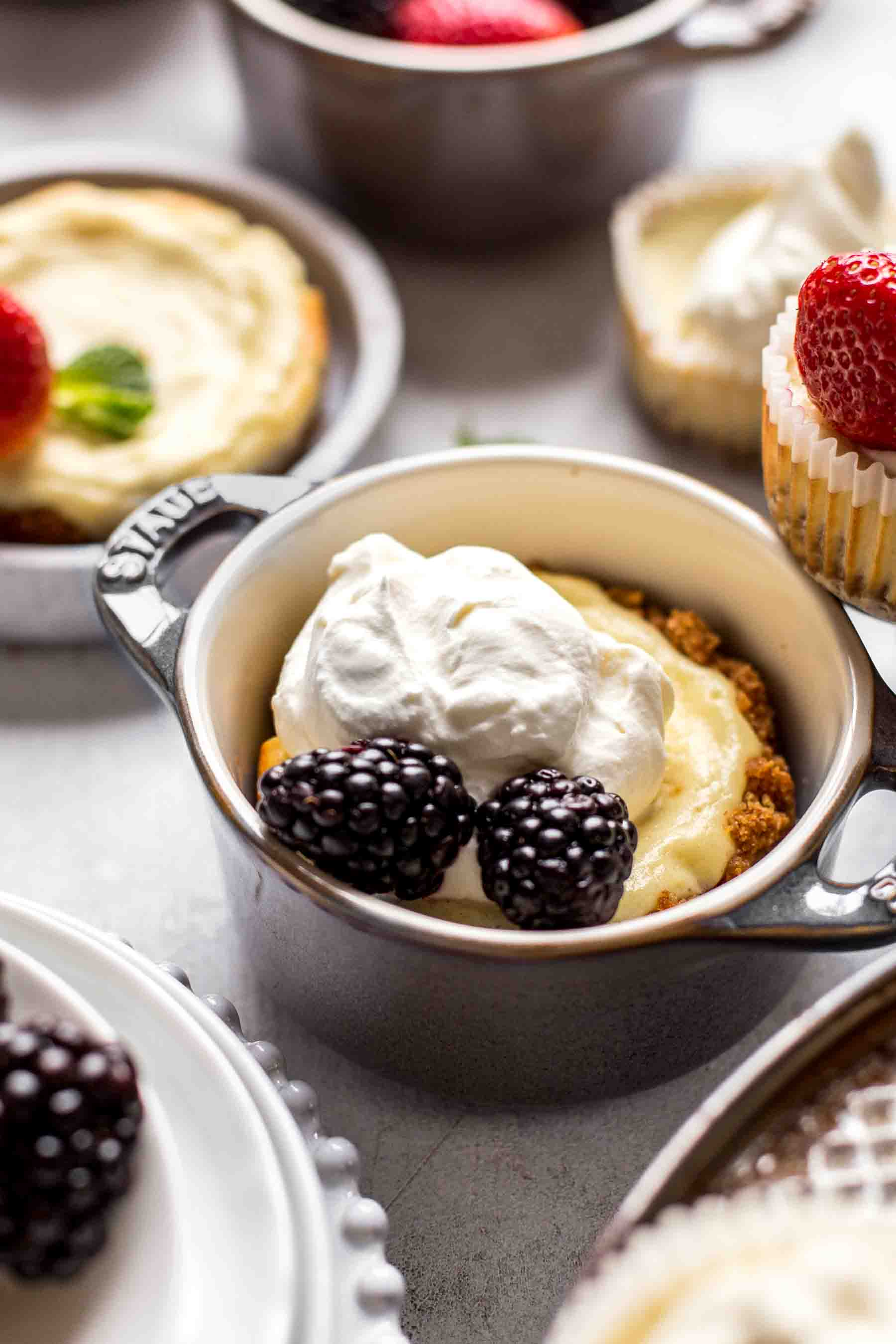 baked mini cheesecake with berries and whipping cream
