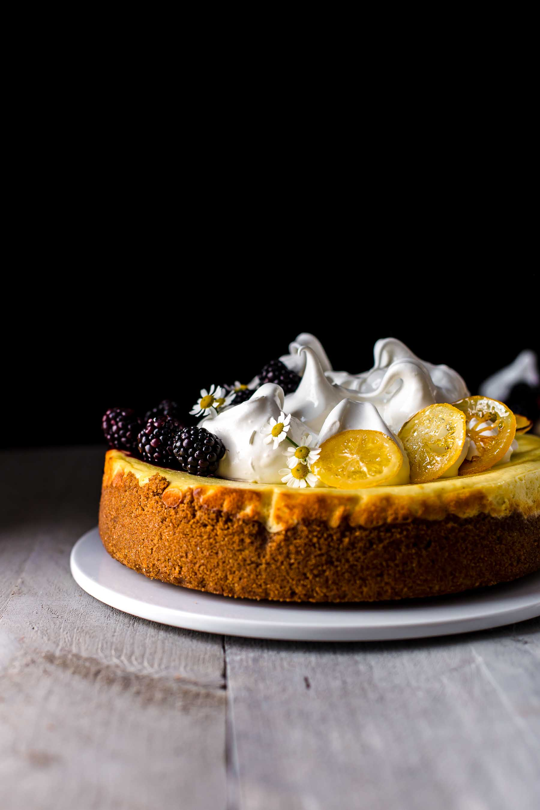Baked and decorated Lemon Cheesecake on serving plate