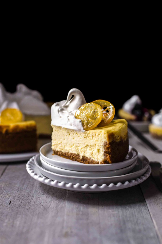 A slice of lemon cheesecake on a dessert plate