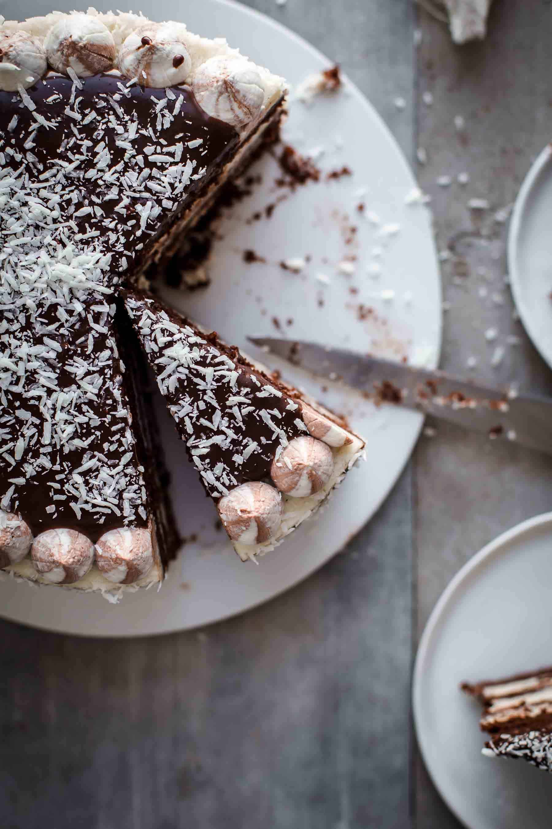 Cut Coconut Chocolate Cake top down on serving plate