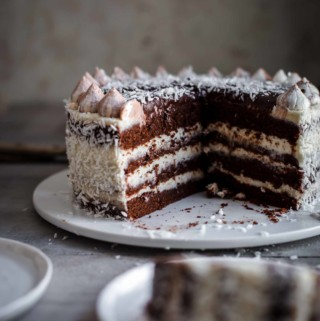 Cut Coconut Chocolate Cake on a serving plate