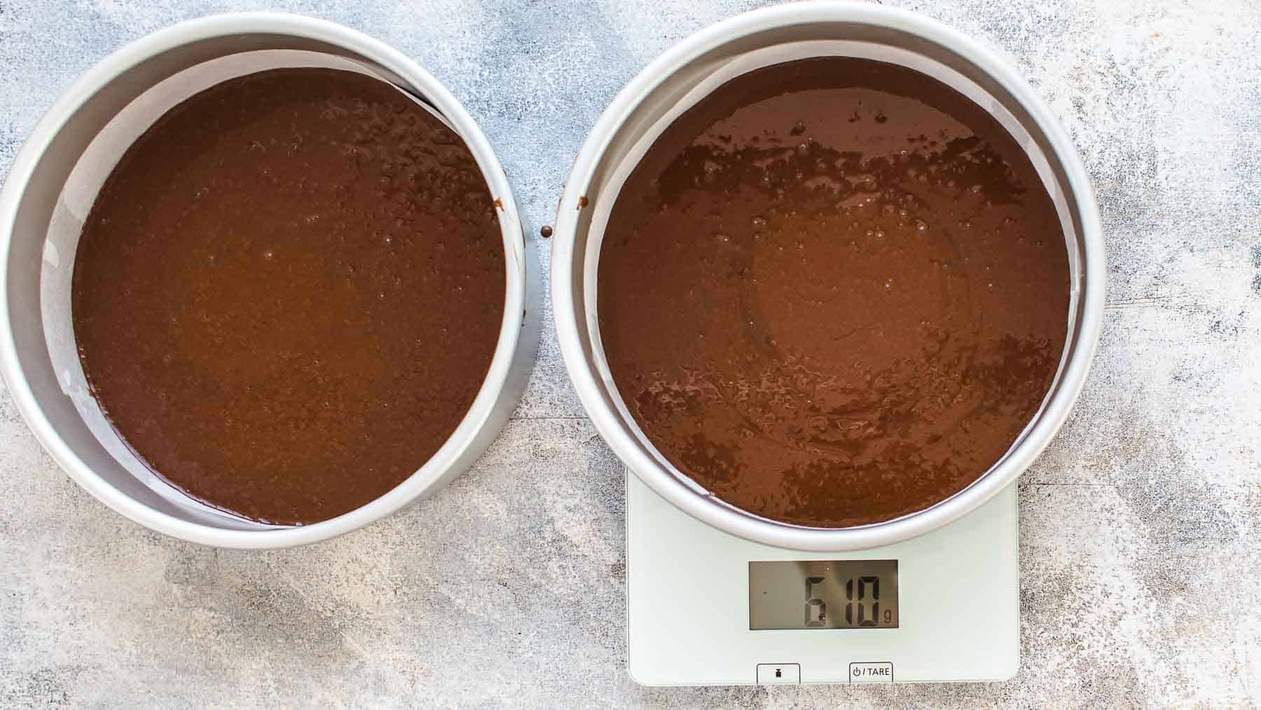 Measuring the chocolate cake batter on kitchen scale