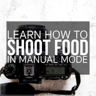 "Camera on white surface with copy ""Learn how to shoot food in manual mode"""