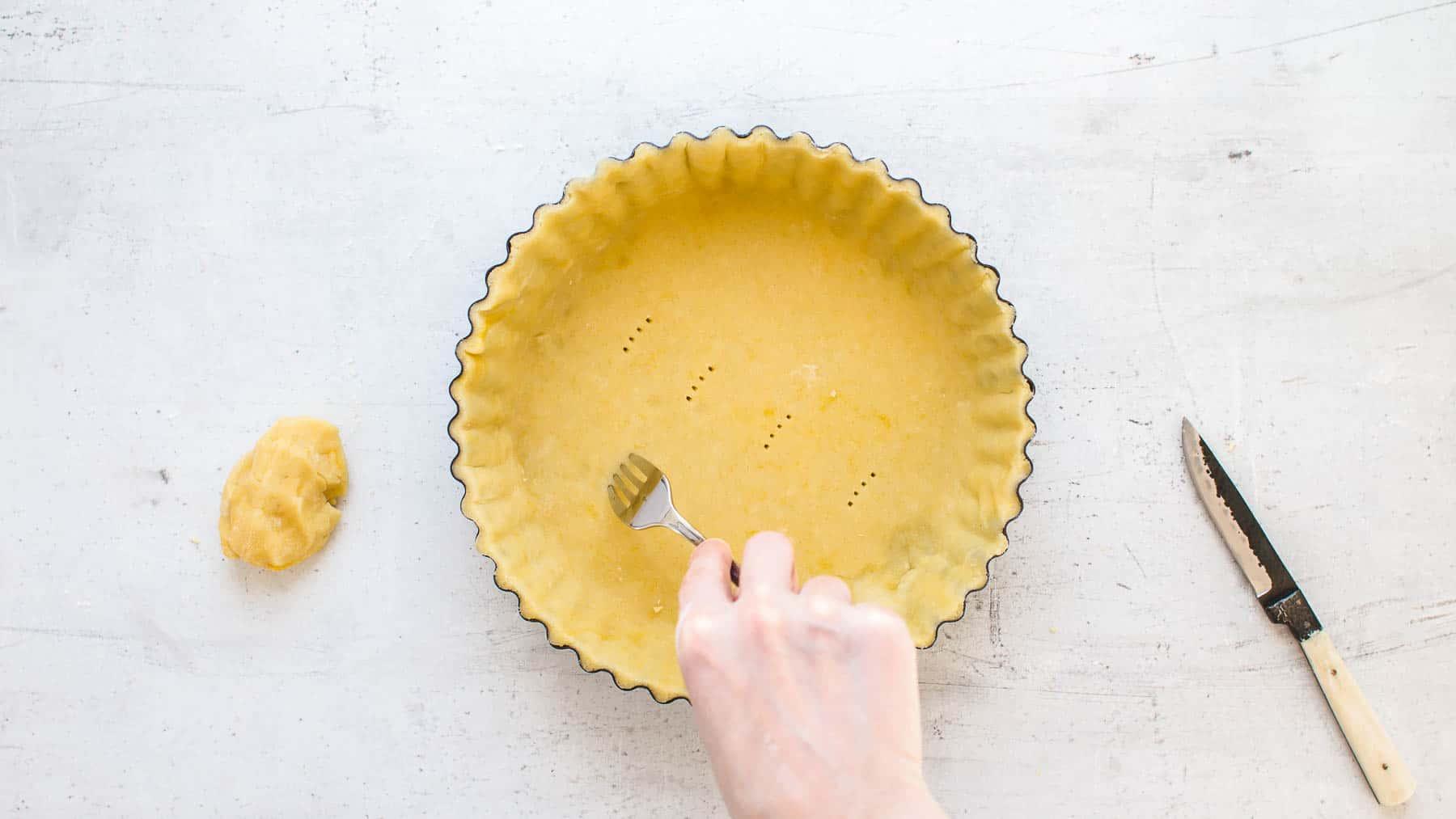 Peaking the bottom of the tart crust