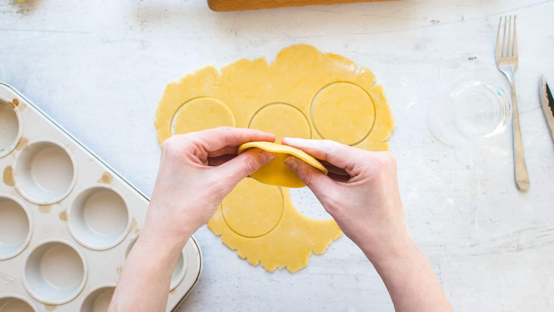 Flattening the crust between the fingers