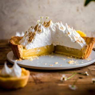Cut Lemon Meringue Tart on serving plate
