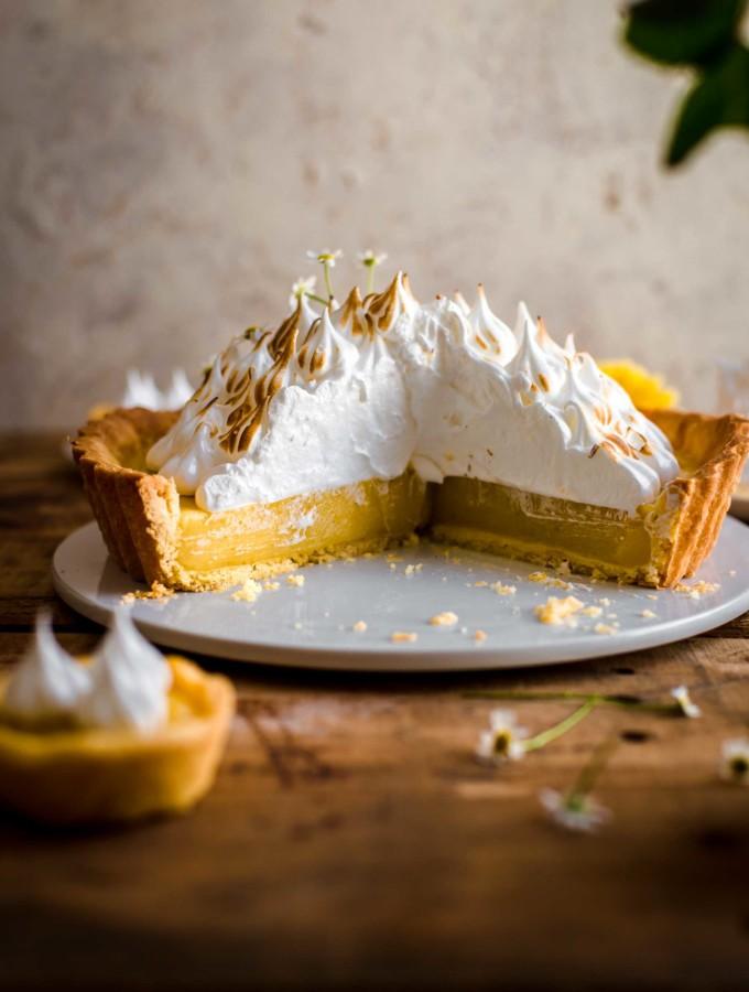 Cut Lemon Meringue Tart on serving plate