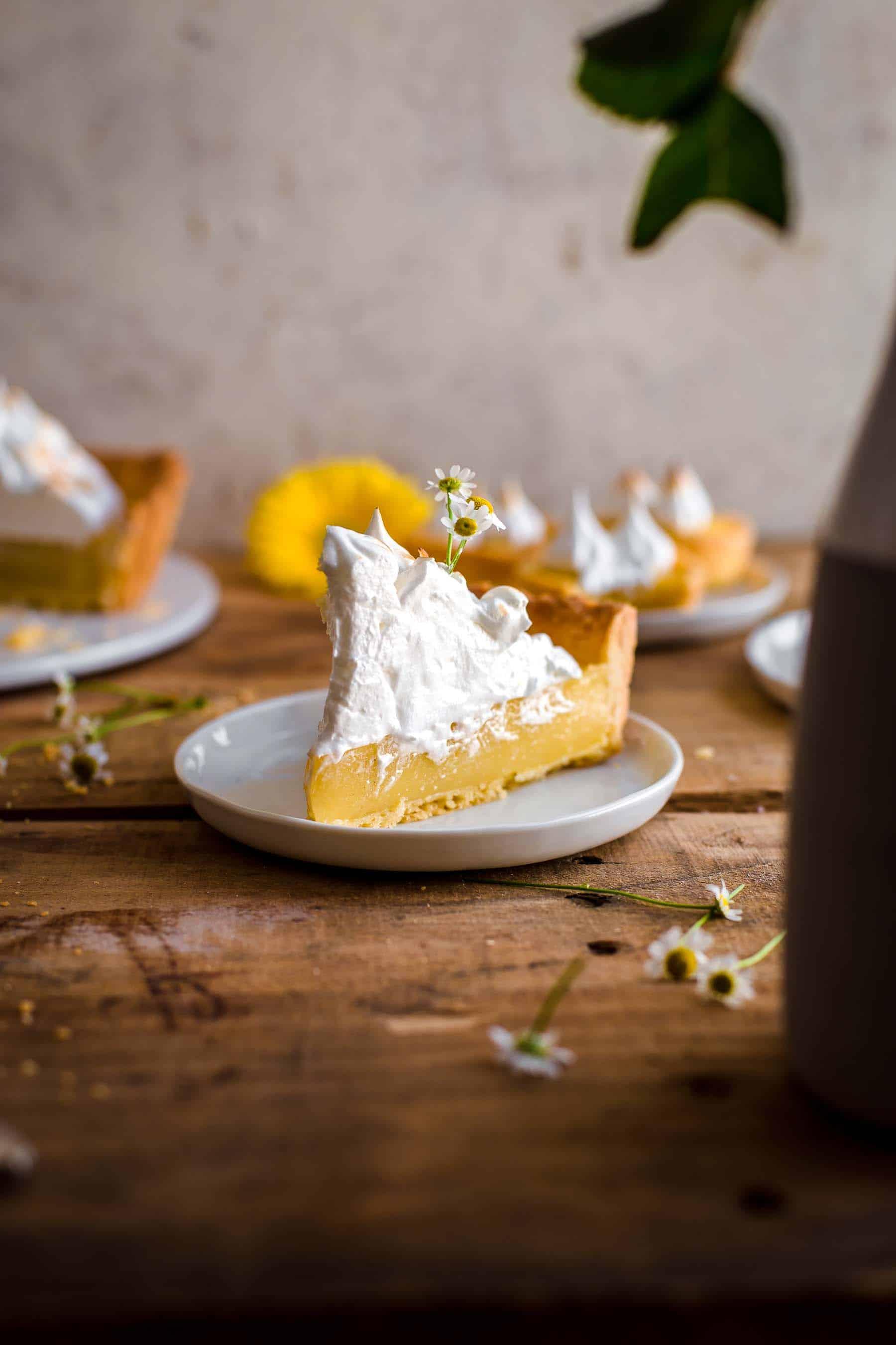 Cut slice of Lemon Meringue Tart on dessert plate