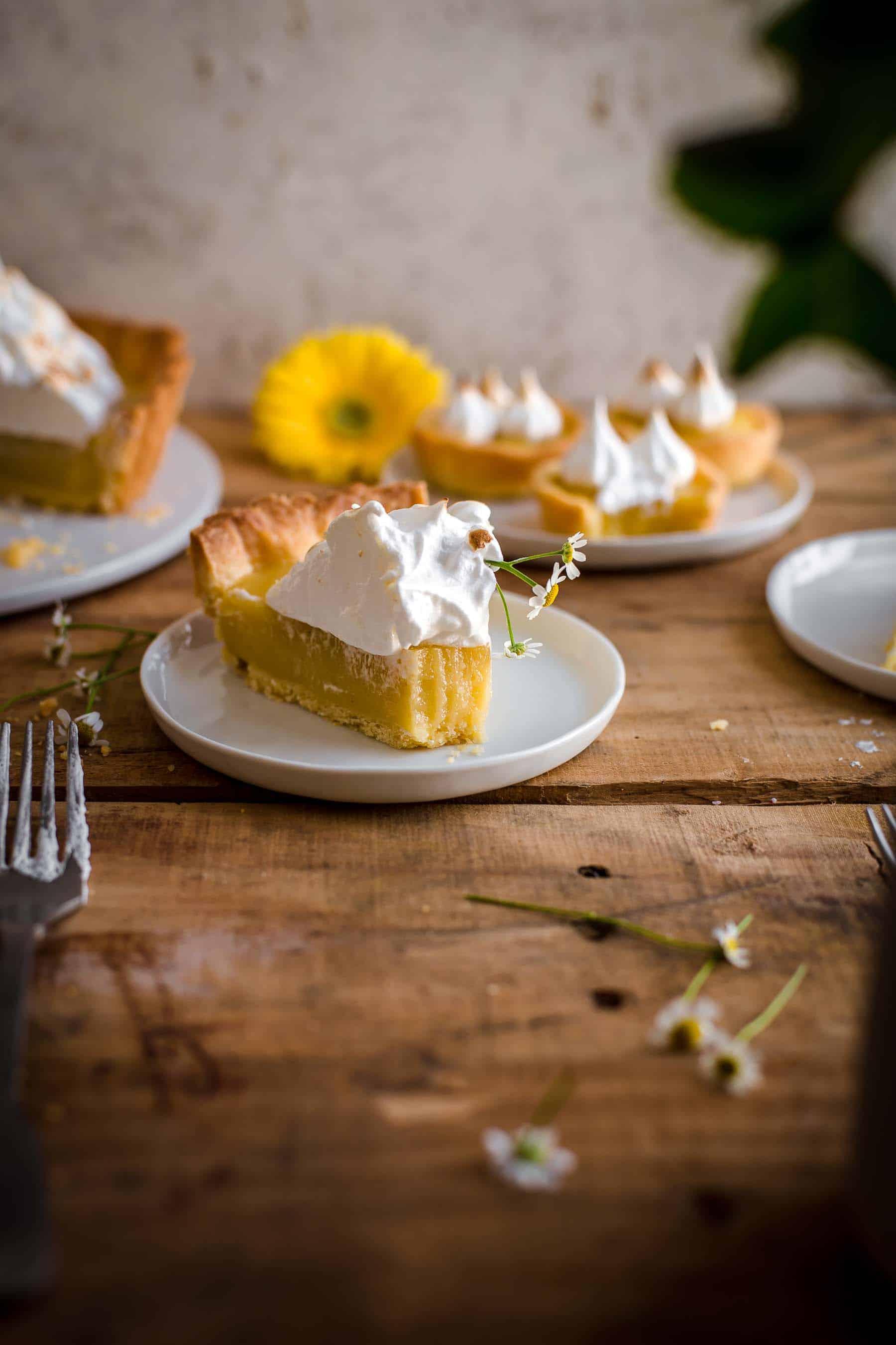 Bitten slice of Lemon Meringue Tart on dessert plate