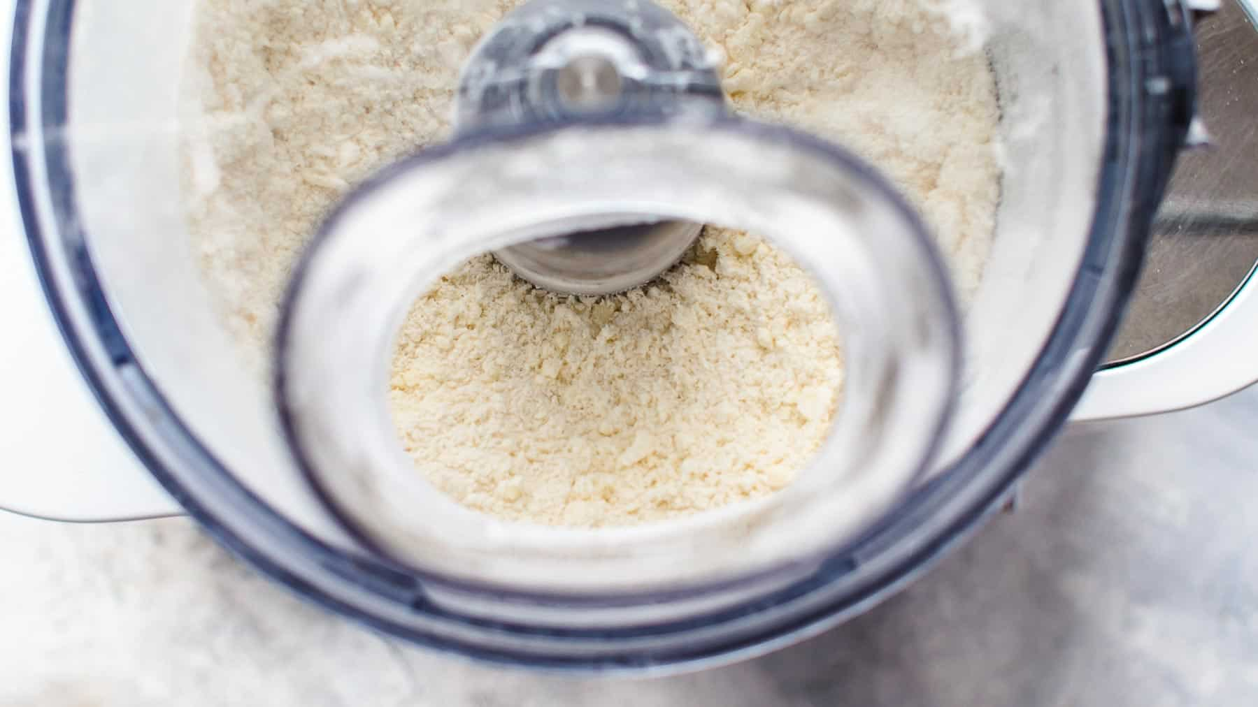 Flour, sugar, salt, and butter processing in food processor