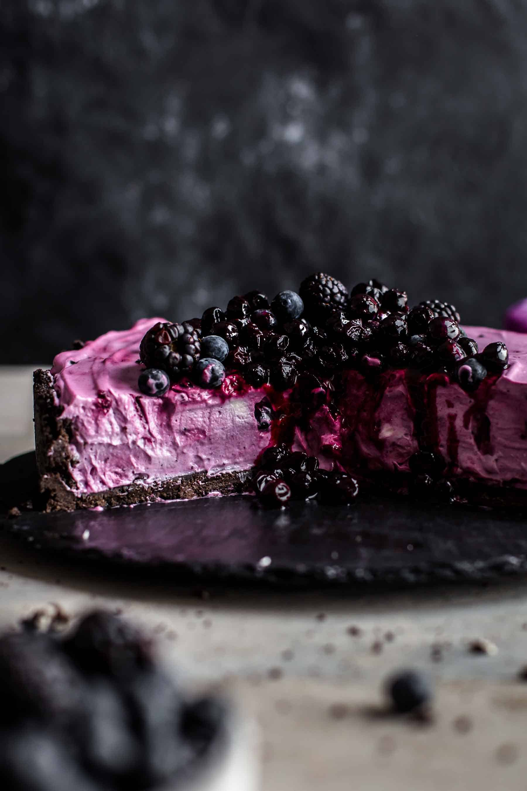 Cut No-bake Blueberry Cheesecake on serving plate
