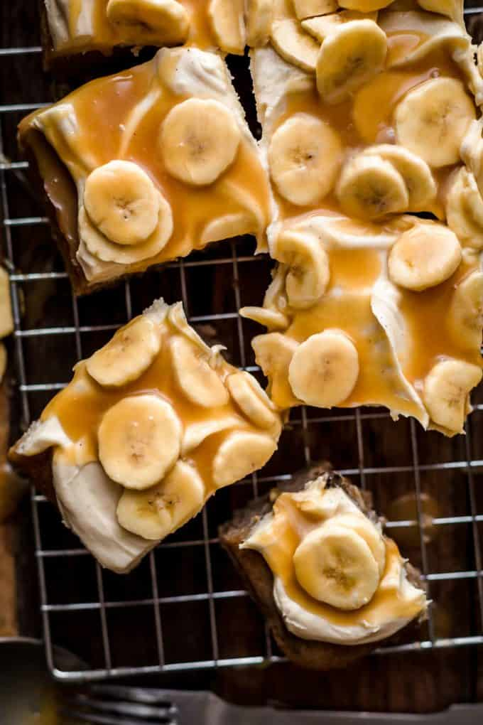Cut Banoffee Cake slices on a wire rack
