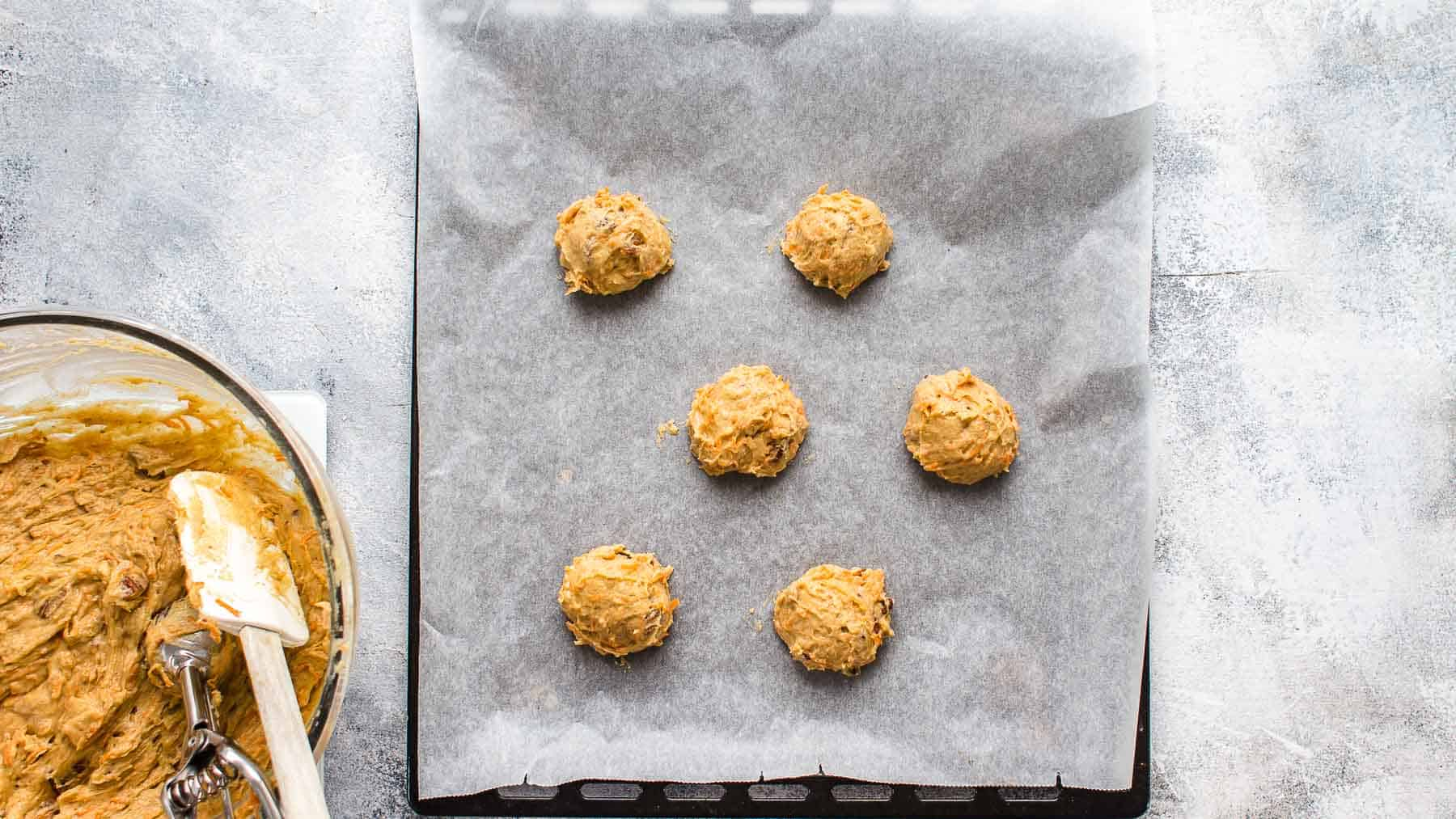 Unbaked cookie dough balls on baking sheet