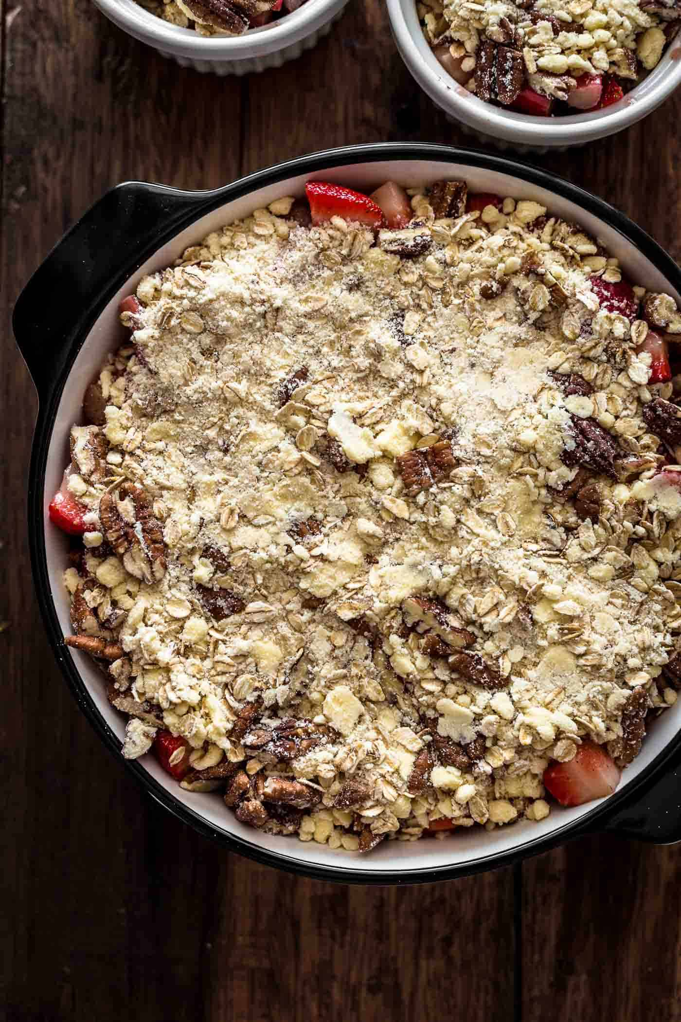 Unbaked Strawberry Rhubarb Crisp in baking dish