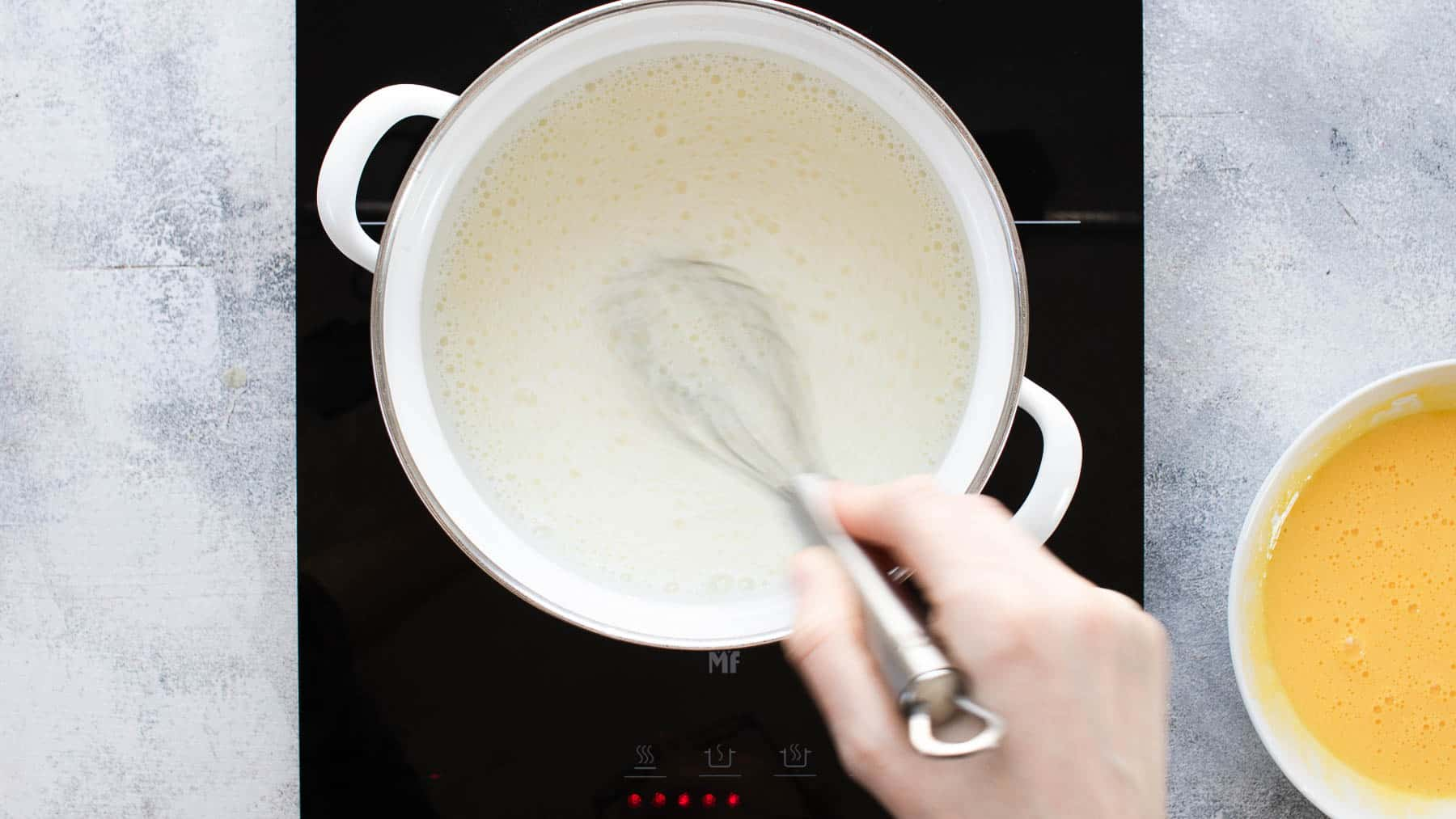 whisking liquid in a pan