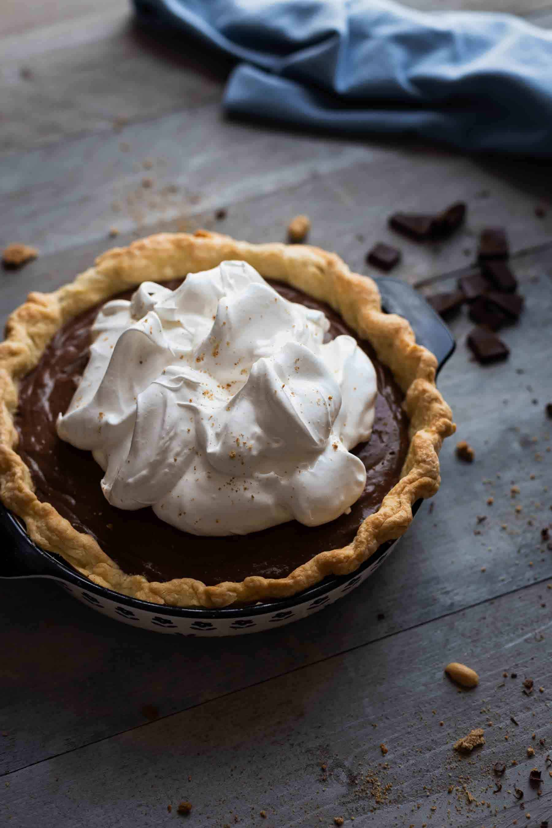 homemade chocolate cream pie with whipped cream on top