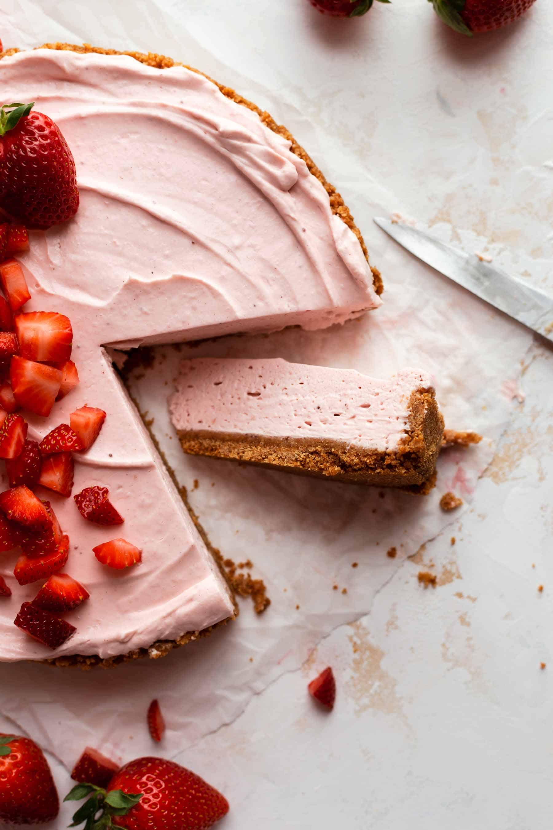 a slice removed from strawberry cream pie