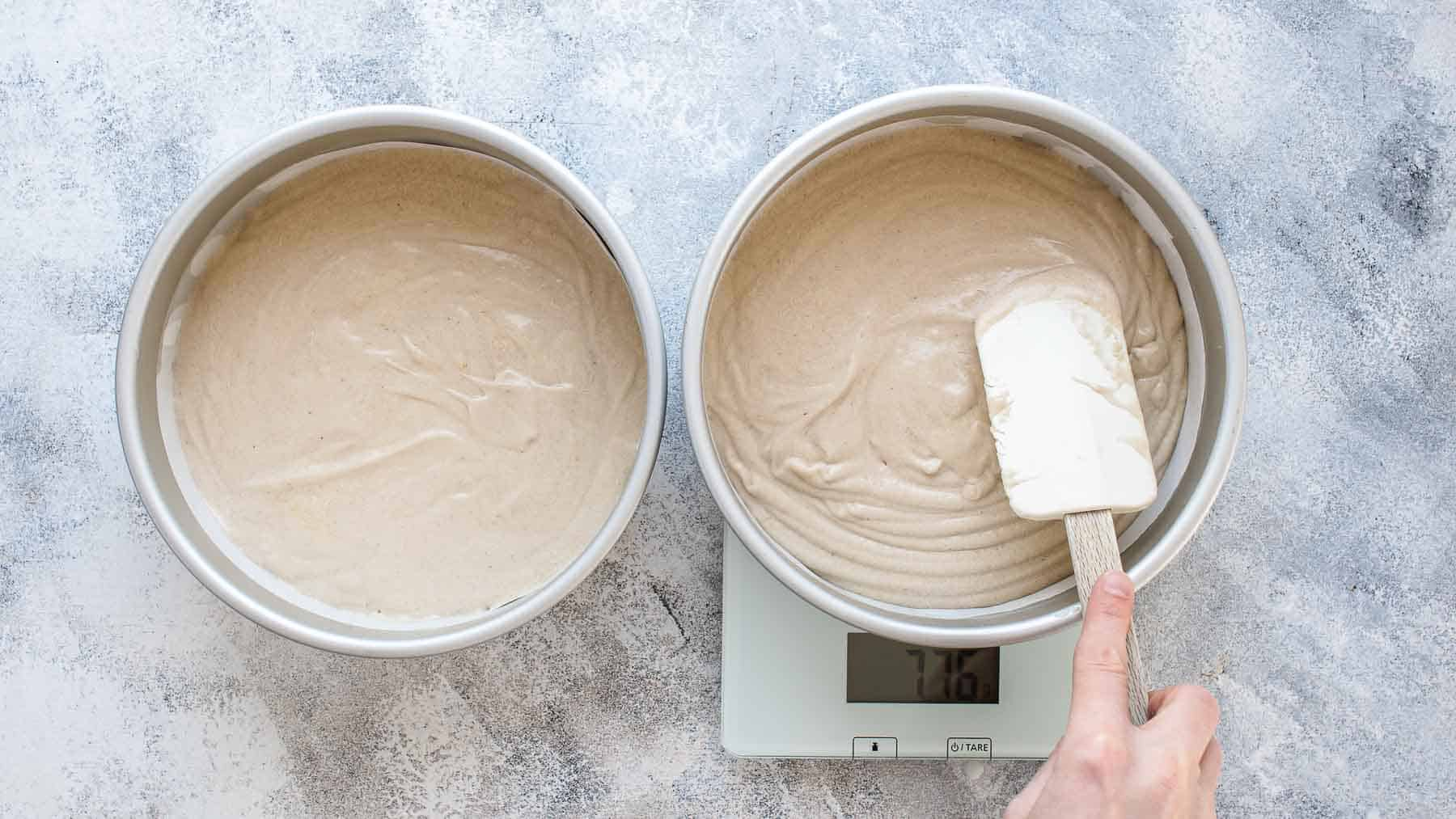 pouring batter into cake pan and measuring