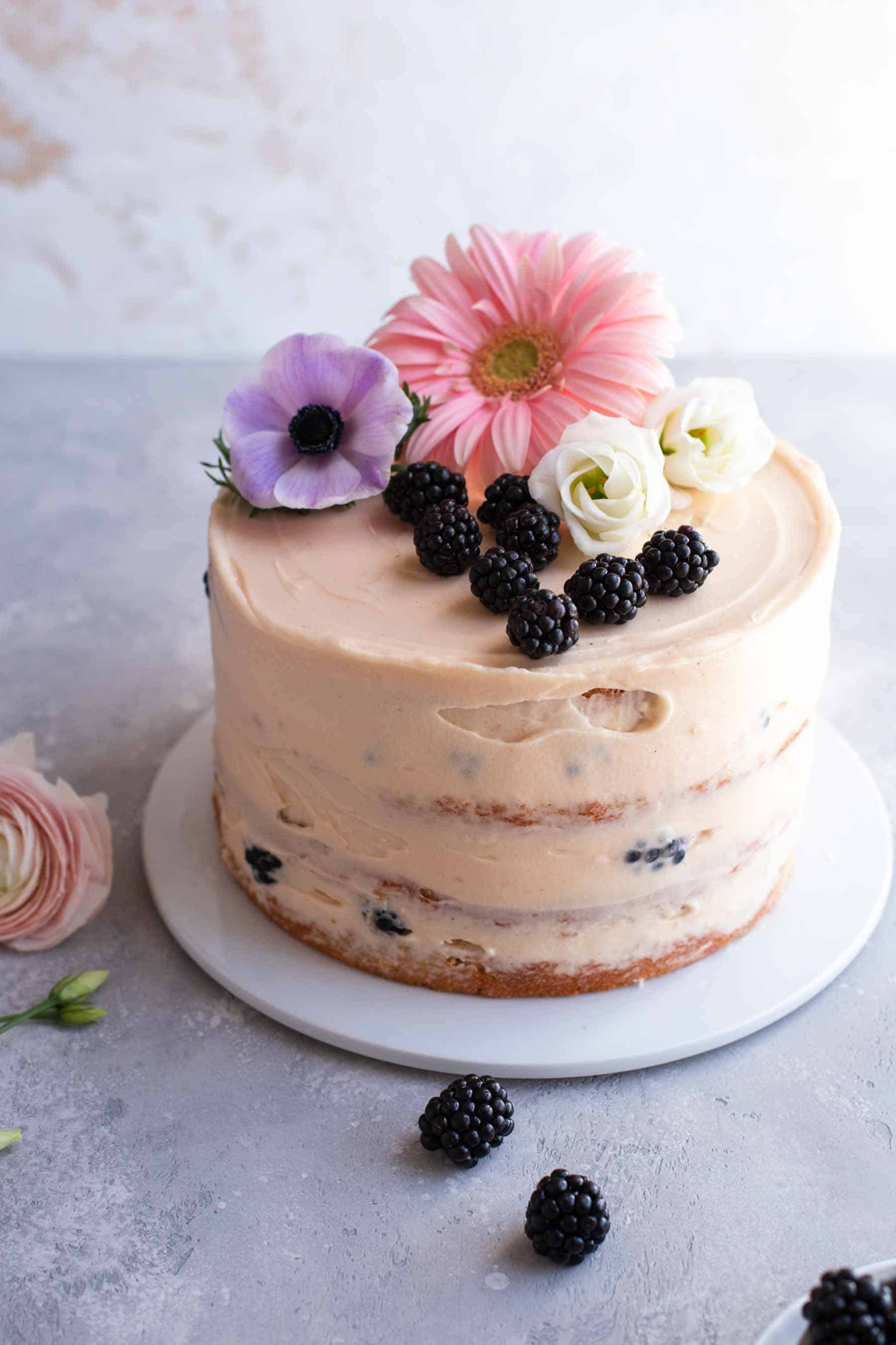 Decorated blackberry cake with flowers on top