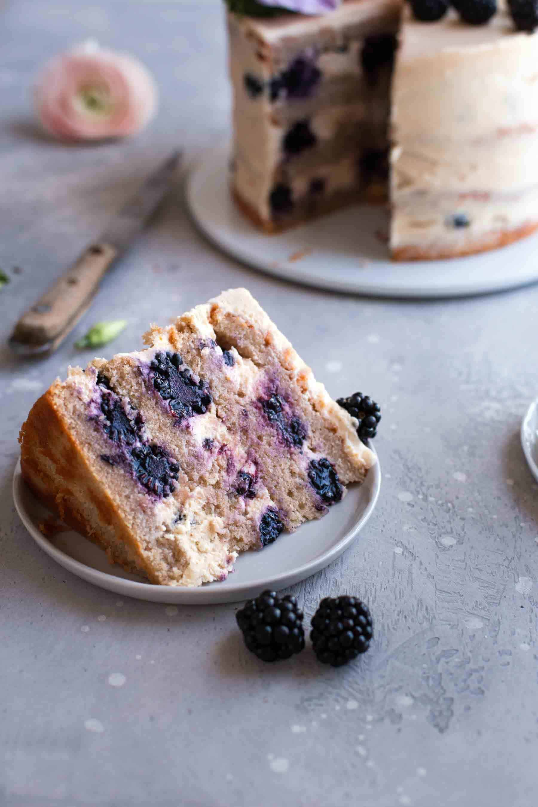 slice of blackberry cake on table