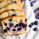 fresh blueberry bread sliced and placed on top of a towel