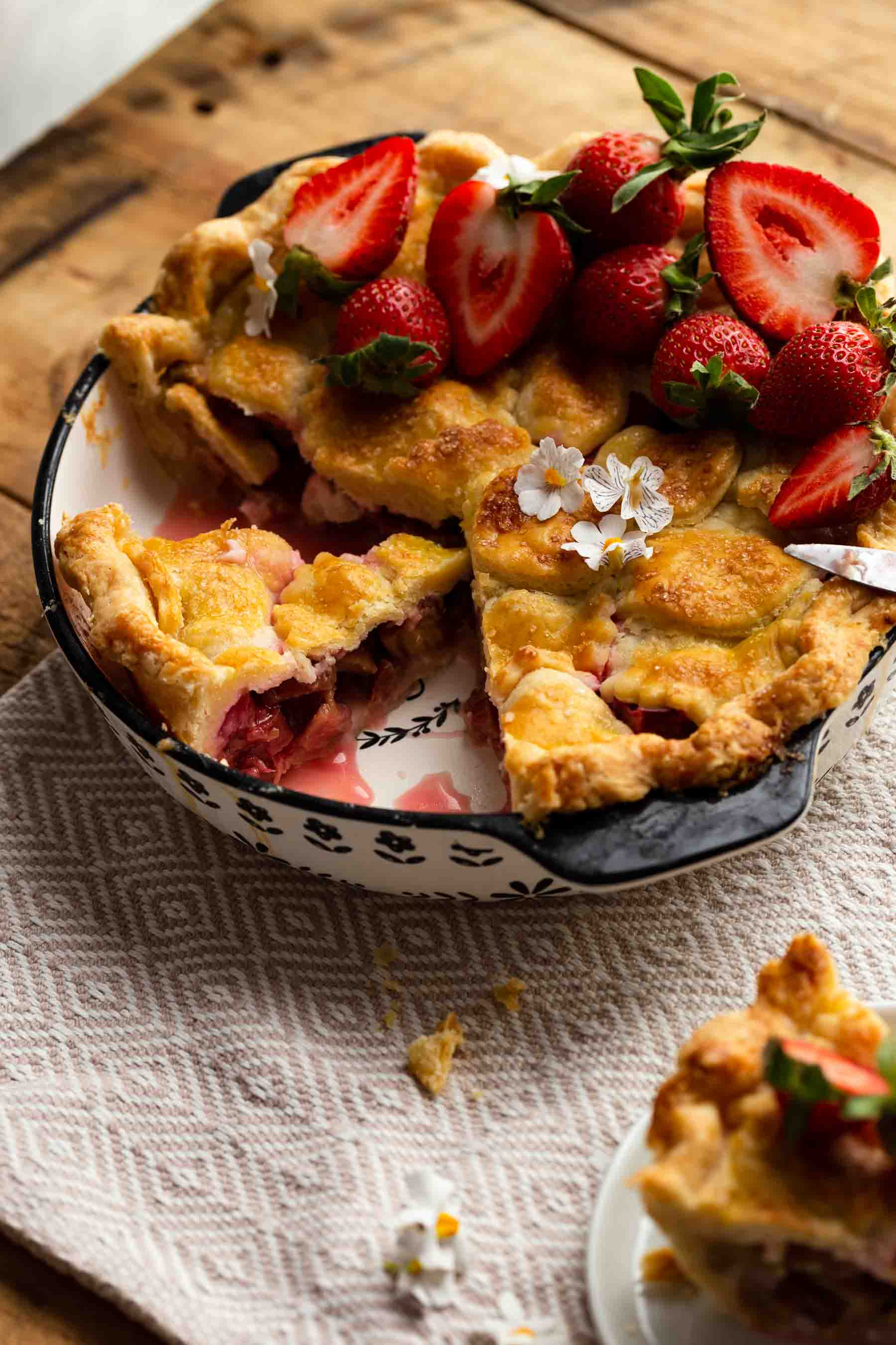 homemade rhubarb pie with double layer of crust on table