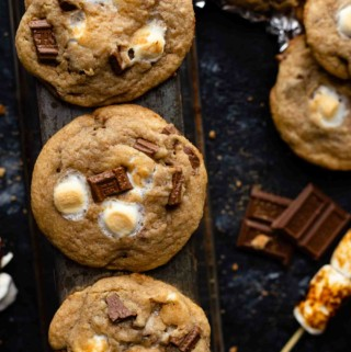 s'mores cookies on table with chocolate by it