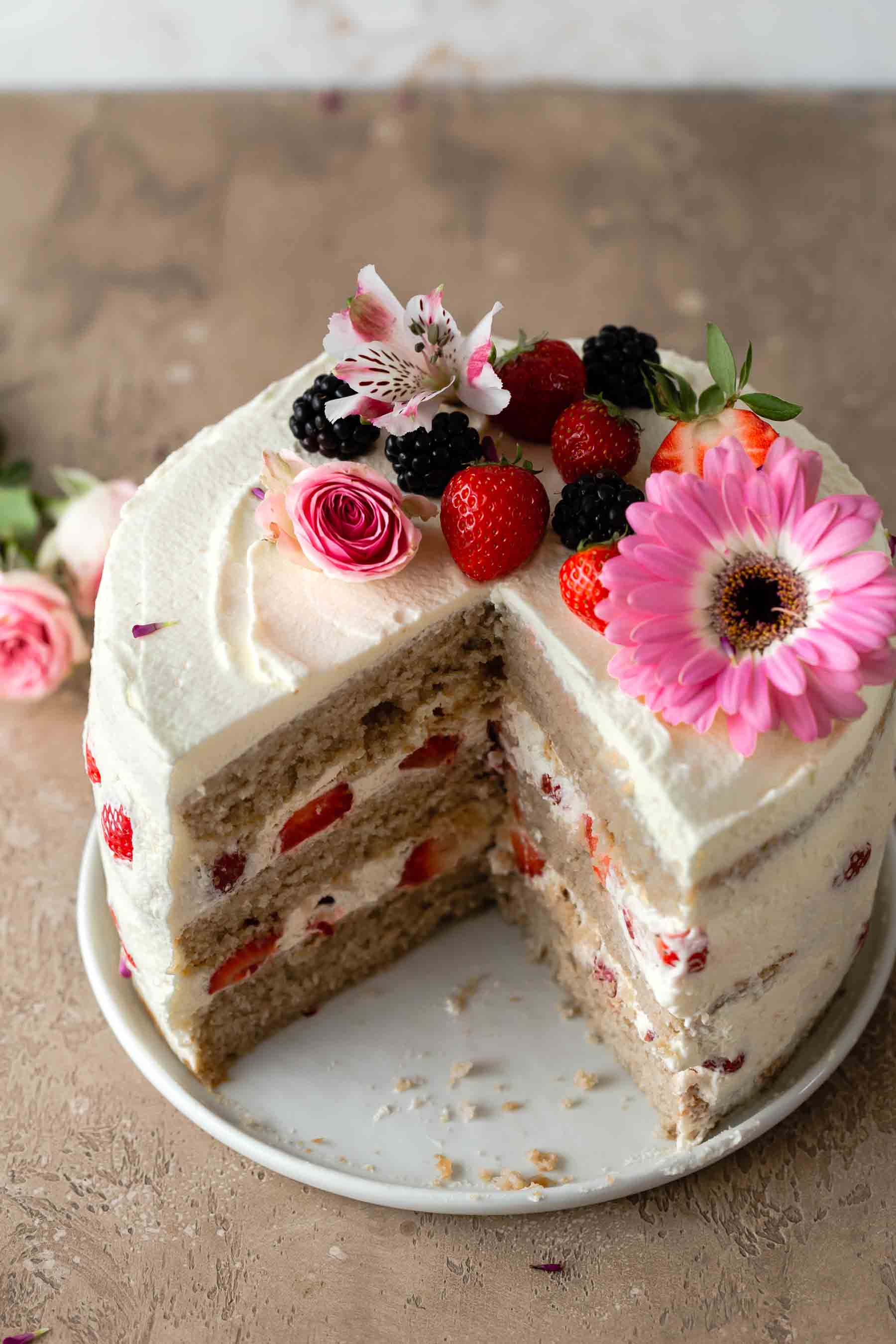 slice cut out of strawberry layer cake