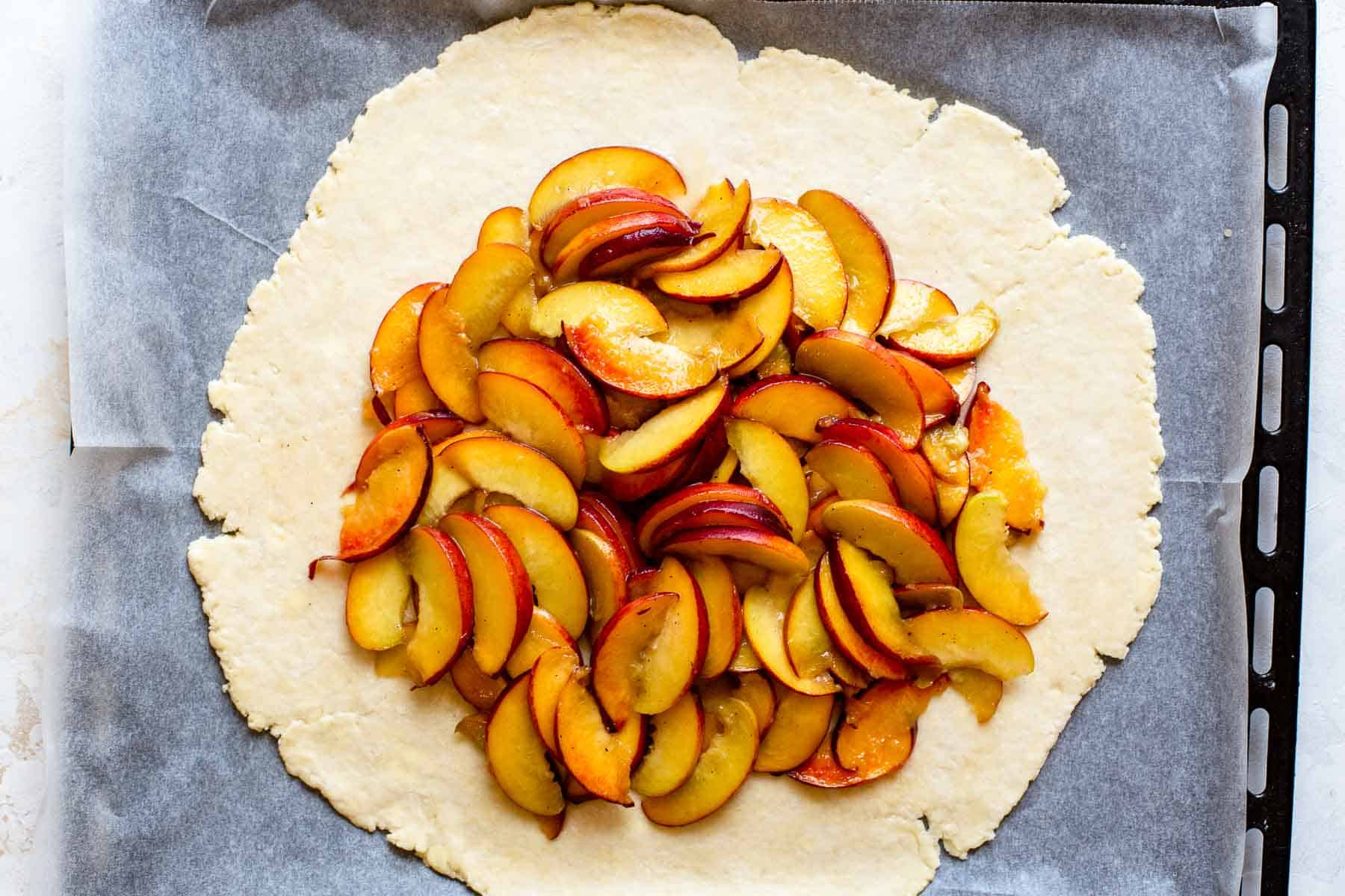 pie crust with peaches in center