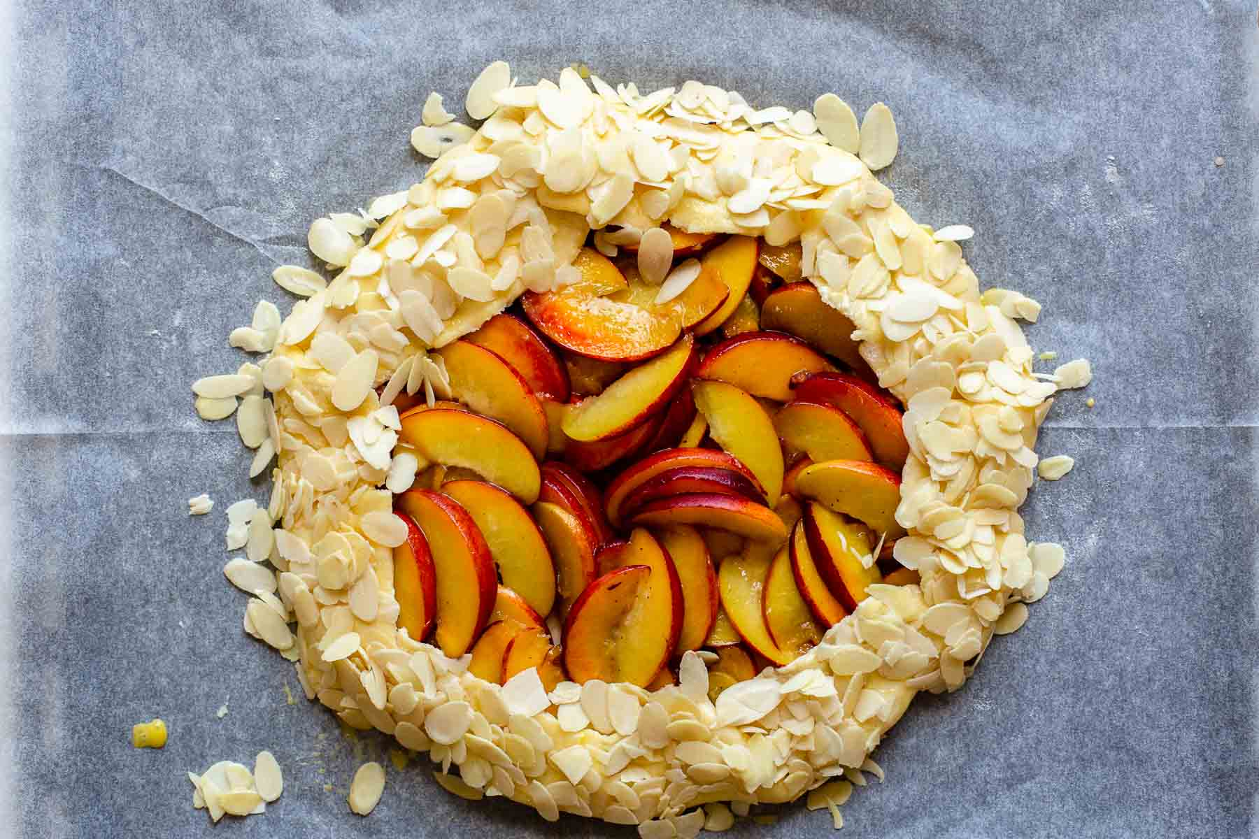 ready to cut almond peach galette on table