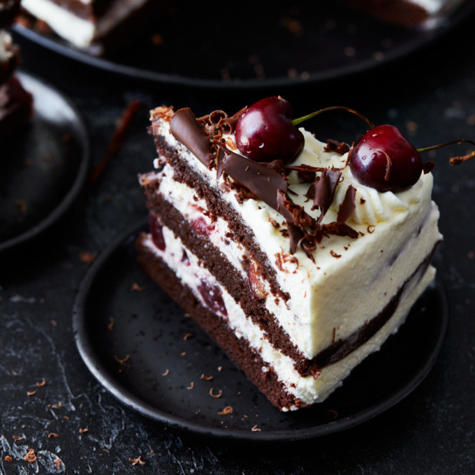 A slice of Black Forest cake on a dessert plate