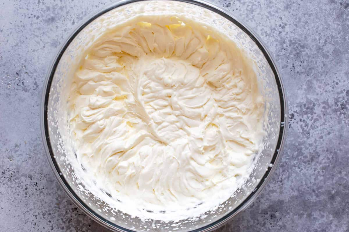 Whipped cream in a large mixing bowl