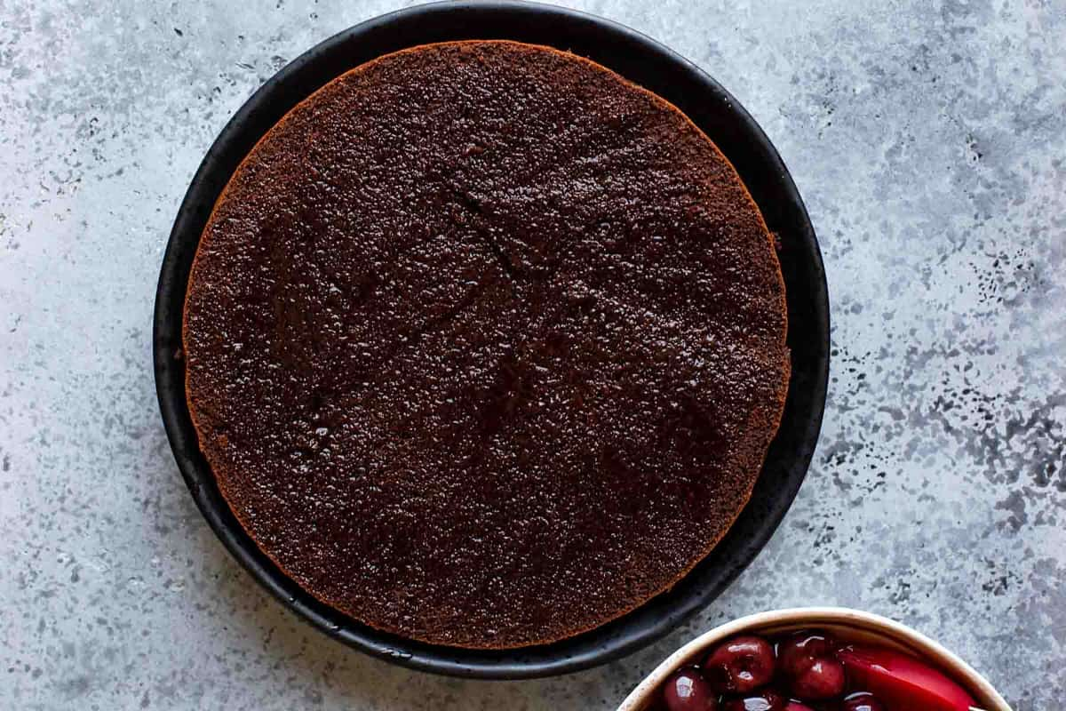 Chocolate cake layer brushed with cherry syrup